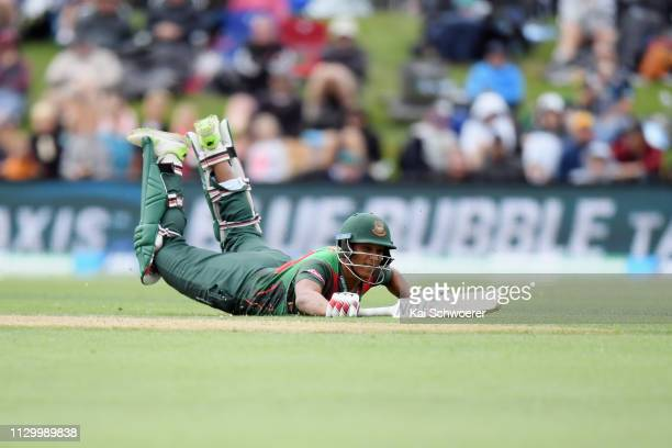 Mohammad Saifuddin of Bangladesh dives to save his wicket during Game 2 of the One Day International series between New Zealand and Bangladesh at...