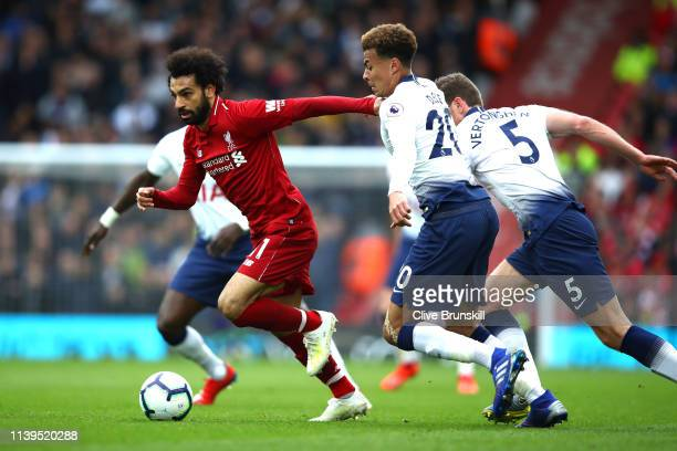 Mohammad Salah of Liverpool is closed down by Dele Ali of Tottenham during the Premier League match between Liverpool FC and Tottenham Hotspur at...