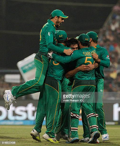 Mohammad Sami celebrates taking the wicket of Suresh Raina of India during the ICC World Twenty20 India 2016 match between Pakistan and India at...