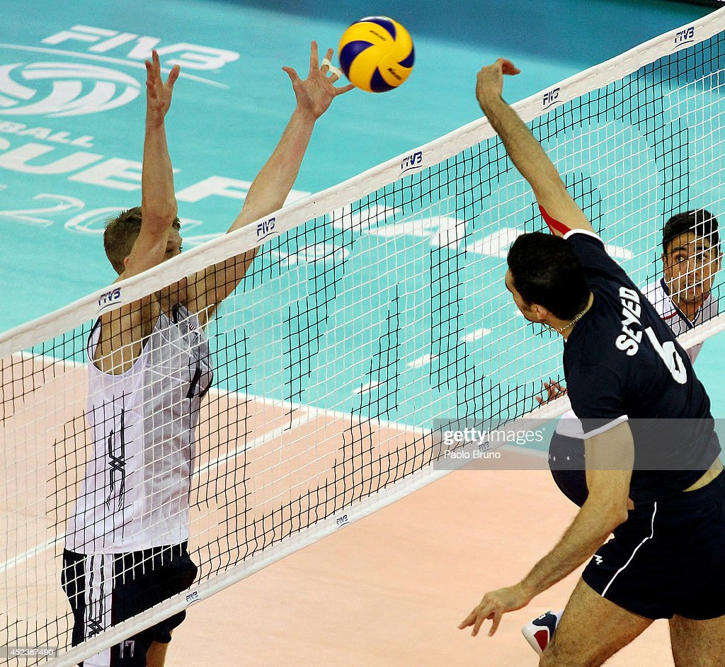 Mohammad Seyed of Iran spikes the ball during the FIVB World League Final Six semifinal match between Iran and United States at Mandela Forum on July 19, 2014 in Florence, Italy.