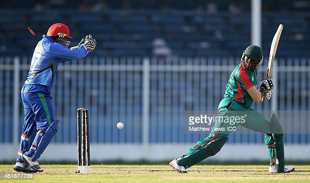Mohammad Shahzad of Afghanistan celebrates after Steve Tikolo of Kenya is bowled by Hamza Hotak during the ICC World Twenty20 Qualifier between...