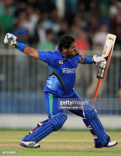 Mohammad Shahzad of Afghanistan celebrates hitting the winning runs during the ICC World Twenty20 Qualifier between Afghanistan and Nepal at the...