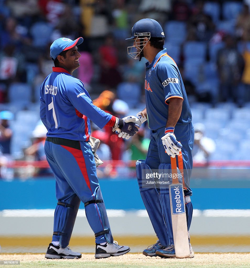 Mohammad Shahzad (L) shakes hands with M S Dhoni of India after the ICC World Twenty20 Group A match between India and Afghanistan played at the Beausejour Cricket Ground on May 1, 2010 in Gros Islet, Saint Lucia.