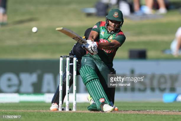 Mohammad Shaifuddin of Bangladesh plays a shot during Game 1 of the One Day International series between New Zealand v Bangladesh at McLean Park on...