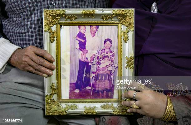 Mohammad Shukor and his wife Noor Jahan hold a photograph of themselves with two of their 11 children taken in Thailand in 1980 on January 12 2019 in...