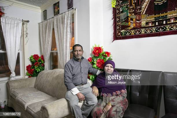 Mohammad Shukor and his wife Noor Jahan pose for a photo in their home on January 12 2019 in Chicago Illinois The Shukor family arrived in Chicago in...