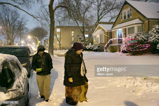 Mohammad Shukor and his wife Noor Jahan walk to visit their daughter at her home on January 12 2019 in Chicago Illinois The Shukor family arrived in...