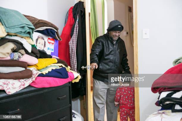 Mohammad Shukor talks to his granddaughter on January 12 2019 in Chicago Illinois The Shukor family arrived in Chicago in 2014 from Malaysia Mohammad...