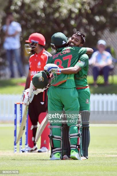Mohammad Tawhid Hridoy of Bangladesh is congratulated by Aminul Islam Biplob of Bangladesh after scoring a century during the ICC U19 Cricket World...