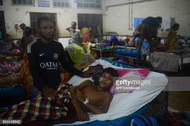 Mohammad Toha Rohingya lies on a bed at the Chittagong Medical College hospital on September 7 2017 The hospital is the only facility in the area...