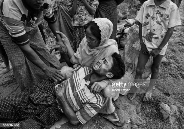 COX'S BAZAR BANGLADESH NOVEMBER 02 Mohammad Yunus a Rohingya Muslim refugee who had not eaten in several days and was overcome by stomach pains is...