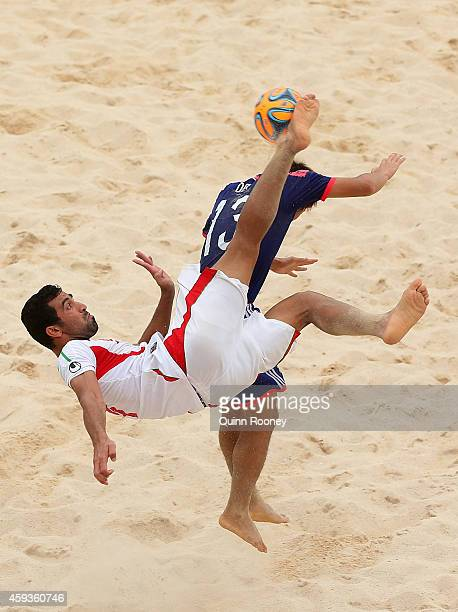 Mohammadali Mokhtari of Iran kicks the ball infront of Takasuke Oba of Japan during the Men's Beach Soccer gold medal match between Iran and Japan...
