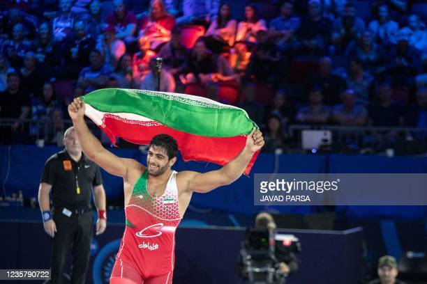 Mohammadhadi Abdollah Saravi from Iran celebrates after winning the 97 kg class final match during the 2021 World Wrestling Championships in Oslo,...