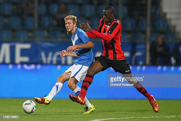 Mohammadou Idrissou of Frankfurt challenges Christoph Kramer of Bochum during the Second Bundesliga match between VfL Bochum and Eintracht Frankfurt...