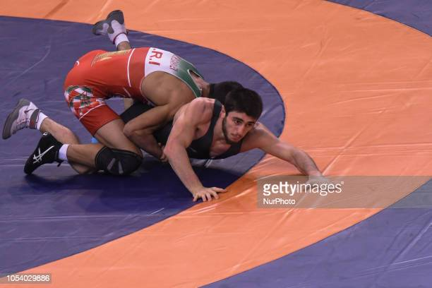 Mohammadreza Abdolhamid GERAEI of Iran against Shmagi BOLKVADZE of Georgia a 1/8 round match in men's GrecoRoman wrestling 67kg category at the World...