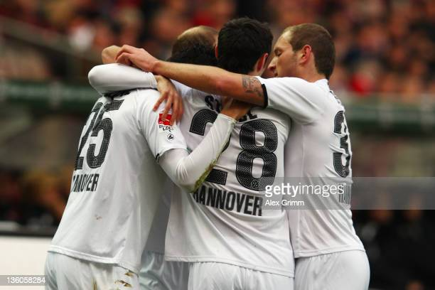 Mohammed Abdellaoue of Hannover celebrates his team's first goal with team mates during the Bundesliga match between 1. FC Kaiserslautern and...