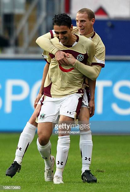 Mohammed Abdellaoue of Hannover celebrates the first goal with Jan Schlaudraff of Hannover during the Bundesliga match between Eintracht Frankfurt...