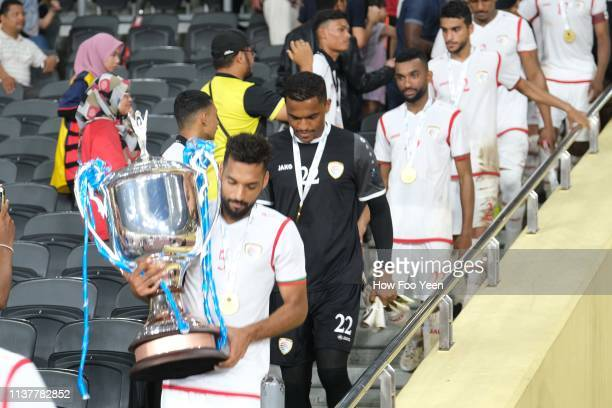 Mohammed Abdullah Mubarak carries the cup during the Airmarine Cup final between Singapore and Oman at Bukit Jalil National Stadium on March 23 2019...