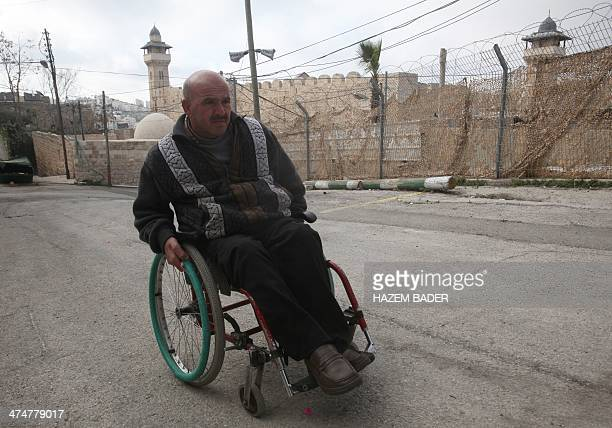 Mohammed Abu alHalawa a survivor who was left a paraplegic after the massacre of 29 Muslims by a Jewish extremist twenty years ago propels his...
