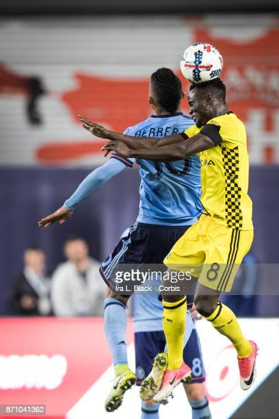 Mohammed Abu of Columbus Crew and Yangel Herrera of New York City FC go up for the ball during the Audi MLS Eastern Conference Semifinal Leg 2 match...