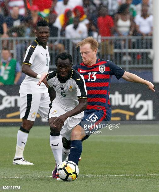 Mohammed Abu of Ghana defends against United States Dax McCarty of the United States in the first half during an international friendly between USA...