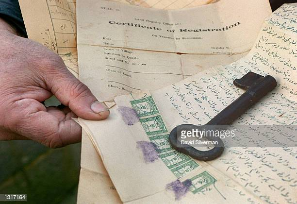 Mohammed Abu Yussef alAffendi a 67yearold Palestinian refugee in the Dehaishe Refugee Camp displays January 21 2001 the original key and title deeds...