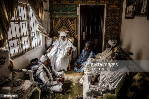 Mohammed Abubakar Bambado, the Sarkin Fulani of Lagos, discuss topics with several members of the Fulani board in his palace at the district of...