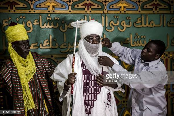 Mohammed Abubakar Bambado the Sarkin Fulani of Lagos is assisted to wear his traditional turban in his palace at the district of Surulere in Lagos...