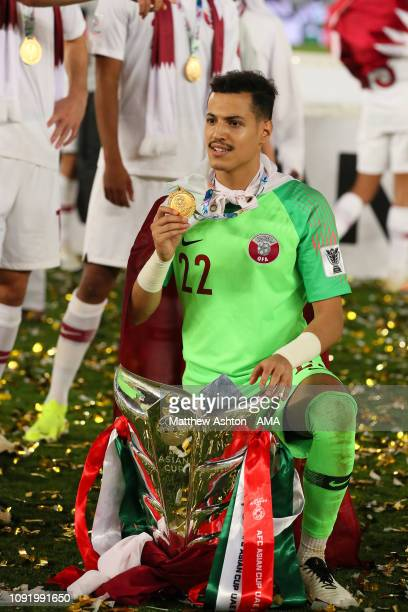 Mohammed Ahmed Albakri of Qatar celebrates with the trophy at the end of the AFC Asian Cup final match between Japan and Qatar at Zayed Sports City...