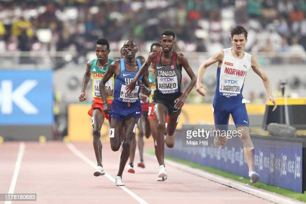 Mohammed Ahmed of Canada competes in the Men's 5000 metres final during day four of 17th IAAF World Athletics Championships Doha 2019 at Khalifa...