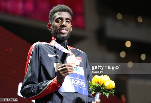 Mohammed Ahmed of Canada poses with the bronze medal for the Men's 5000 Metres during day five of 17th IAAF World Athletics Championships Doha 2019...