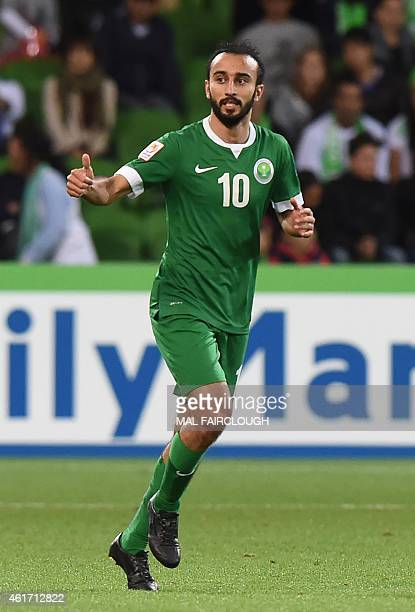 Mohammed Al Sahlawi of Saudi Arabia reacts after scoring a goal during the Group B Asian Cup football match between Uzbekistan and Saudi Arabia in...