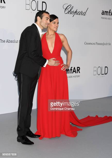 Mohammed Al Turki and Michelle Rodriguez arrive at the amfAR Gala Cannes 2018 at Hotel du CapEdenRoc on May 17 2018 in Cap d'Antibes France