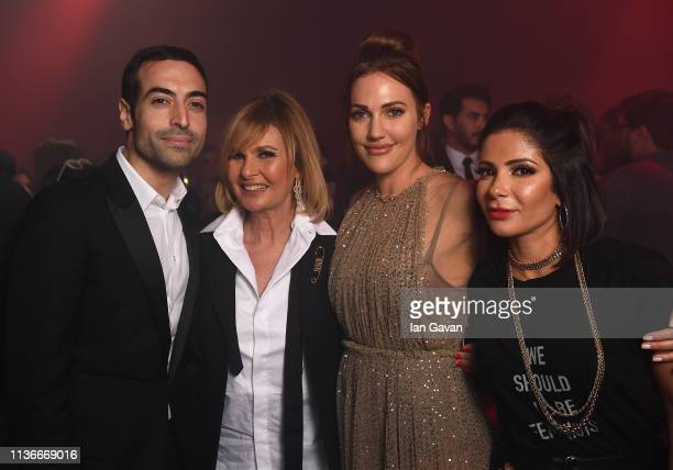 Mohammed Al Turki, Yousra, Meryem Uzerli and Mona Zaki pose during the after-party following the Christian Dior Haute Couture Spring Summer 2019...