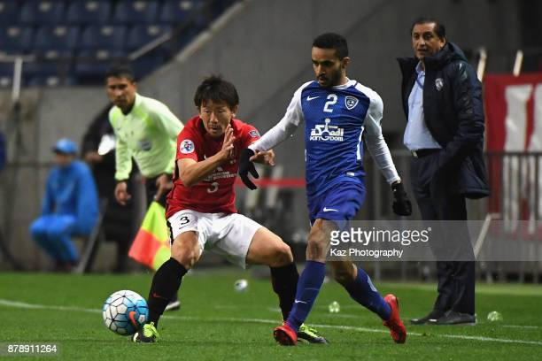 Mohammed AlBurayk of AlHilal and Tomoya Ugajin of Urawa Red Diamonds compete for the ball during the AFC Champions League Final second leg match...