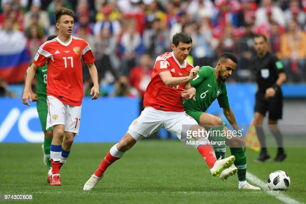 Mohammed Alburayk of Saudi Arabia battles for possession with Alan Dzagoev of Russia during the 2018 FIFA World Cup Russia Group A match between...