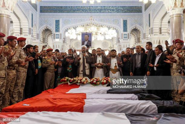 Mohammed Ali alHuthi head of the Huthi rebels' Supreme Revolutionary Committee stands in prayer alongside Mahdi alMashat who was appointed to succeed...