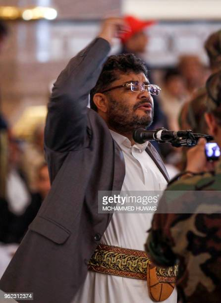 Mohammed Ali alHuthi head of the Huthi rebels' Supreme Revolutionary Committee speaks in a microphone as he gives a speech during the funeral of...