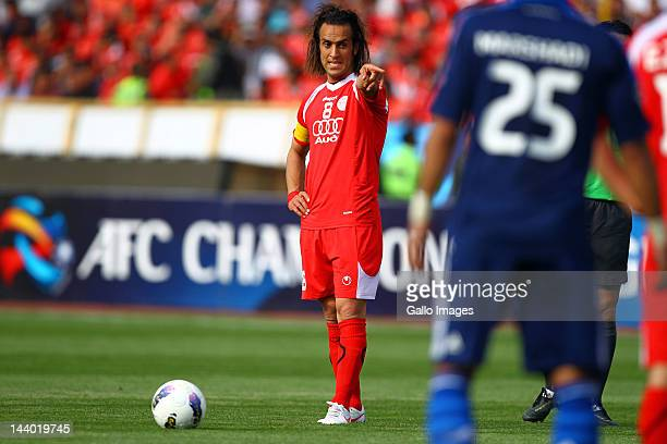TEHRAN IRAN MAY 01 Mohammed Ali Karimi of Persepolis FC takes a free kick during the AFC Champions League match between Persepolis FC and Al Hilal at...