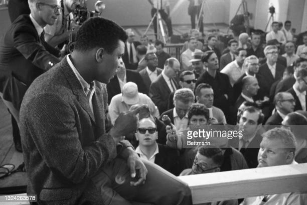 Mohammed Ali meets the press as newly-crowned heavyweight champ of the world. The champ conducted himself in a manner befitting a champ, in drastic...