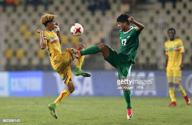Mohammed Ali of Iraq battles with Salam Jiddou of Mali during the FIFA U17 World Cup India 2017 Round of 16 match between Mali and Iraq at Pandit...