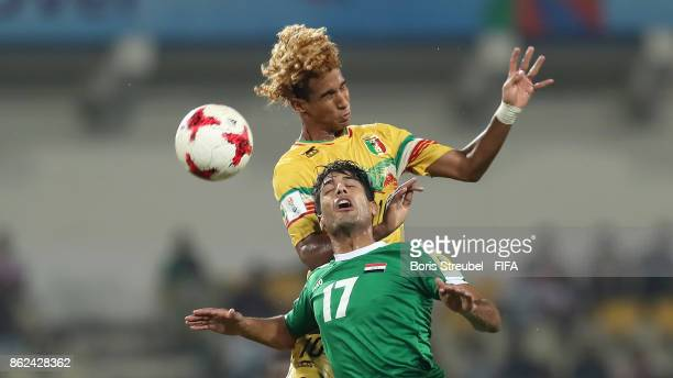 Mohammed Ali of Iraq jumps for a header with Salam Jiddou of Mali during the FIFA U17 World Cup India 2017 Round of 16 match between Mali and Iraq at...