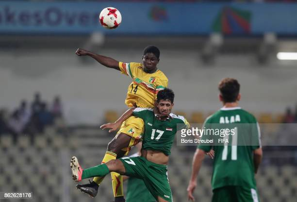 Mohammed Ali of Iraq jumps for a header with Siaka Sidibe of Mali during the FIFA U17 World Cup India 2017 Round of 16 match between Mali and Iraq at...