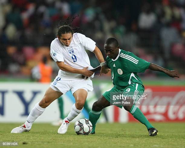 Mohammed Aliyo of Nigeria and Hector Matute of Honduras battle for the ball during the FIFA U17 World Cup Group A match between Nigeria and Honduras...