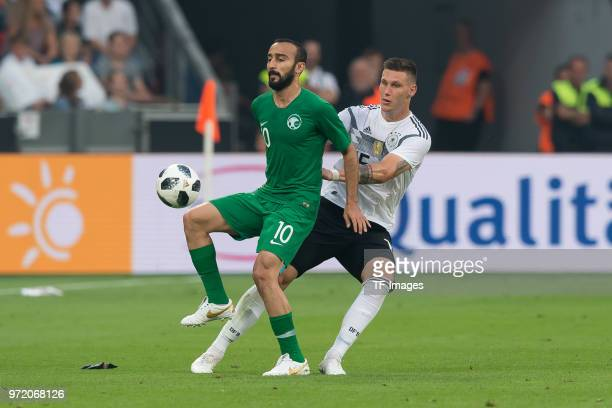 Mohammed AlSahlawi of Saudi Arabia and Niklas Suele of Germany battle for the ball during the international friendly match between Germany and Saudi...
