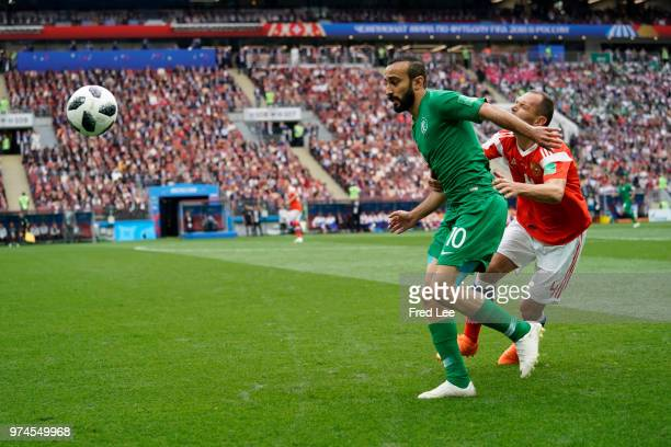 Mohammed AlSahlawi of Saudi Arabia heads the ball during the 2018 FIFA World Cup Russia group A match between Russia and Saudi Arabia at Luzhniki...