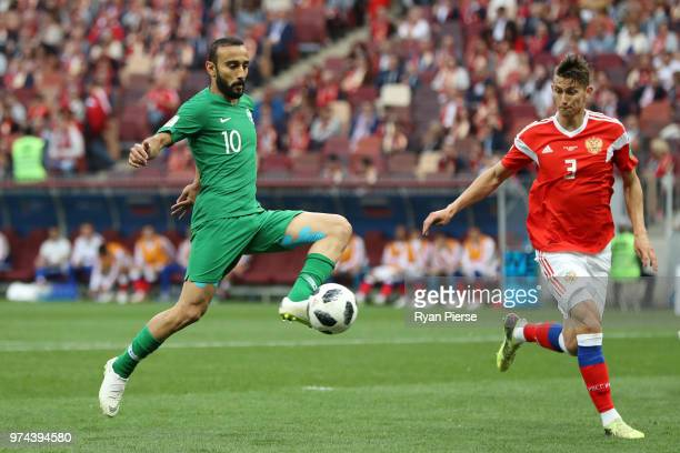 Mohammed Alsahlawi of Saudi Arabia is challenged by Ilya Kutepov of Russia during the 2018 FIFA World Cup Russia Group A match between Russia and...