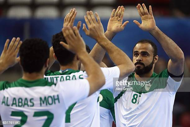 Mohammed Alzaer of Saudi Arabia celebrates a goal during the 25th IHF Men's World Championship 2017 match between Saudi Arabia and Belarus at...