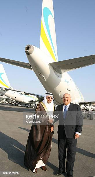 Mohammed AlZeer Chairman of MAZ Aviation shakes hands with Comlux Group President Richard Gaona at the air show at the Sakhir Airbase in Manama on...