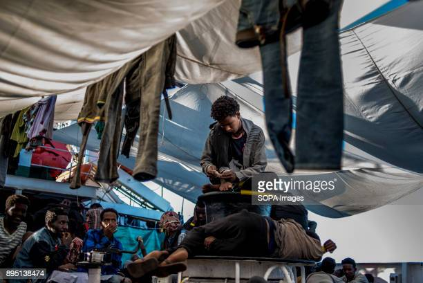 Mohammed an 18 years old Eritrean looking to his photos the only memories he is carrying with him He was coming from Libya and rescued by the Spanish...